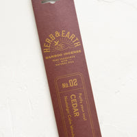Cedar: A brown packaging sleeve containing cedar scented incense.
