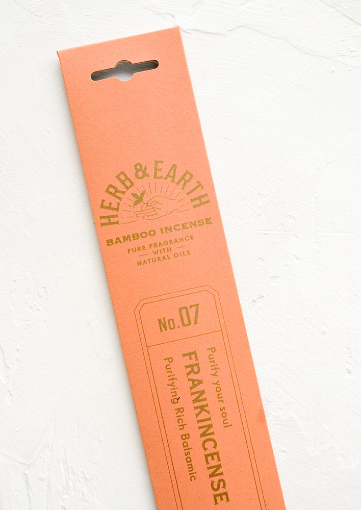 Frankincense: A salmon pink packaging sleeve containing frankincense scented incense.