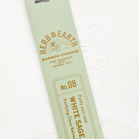 White Sage: A mint green packaging sleeve containing sage scented incense.