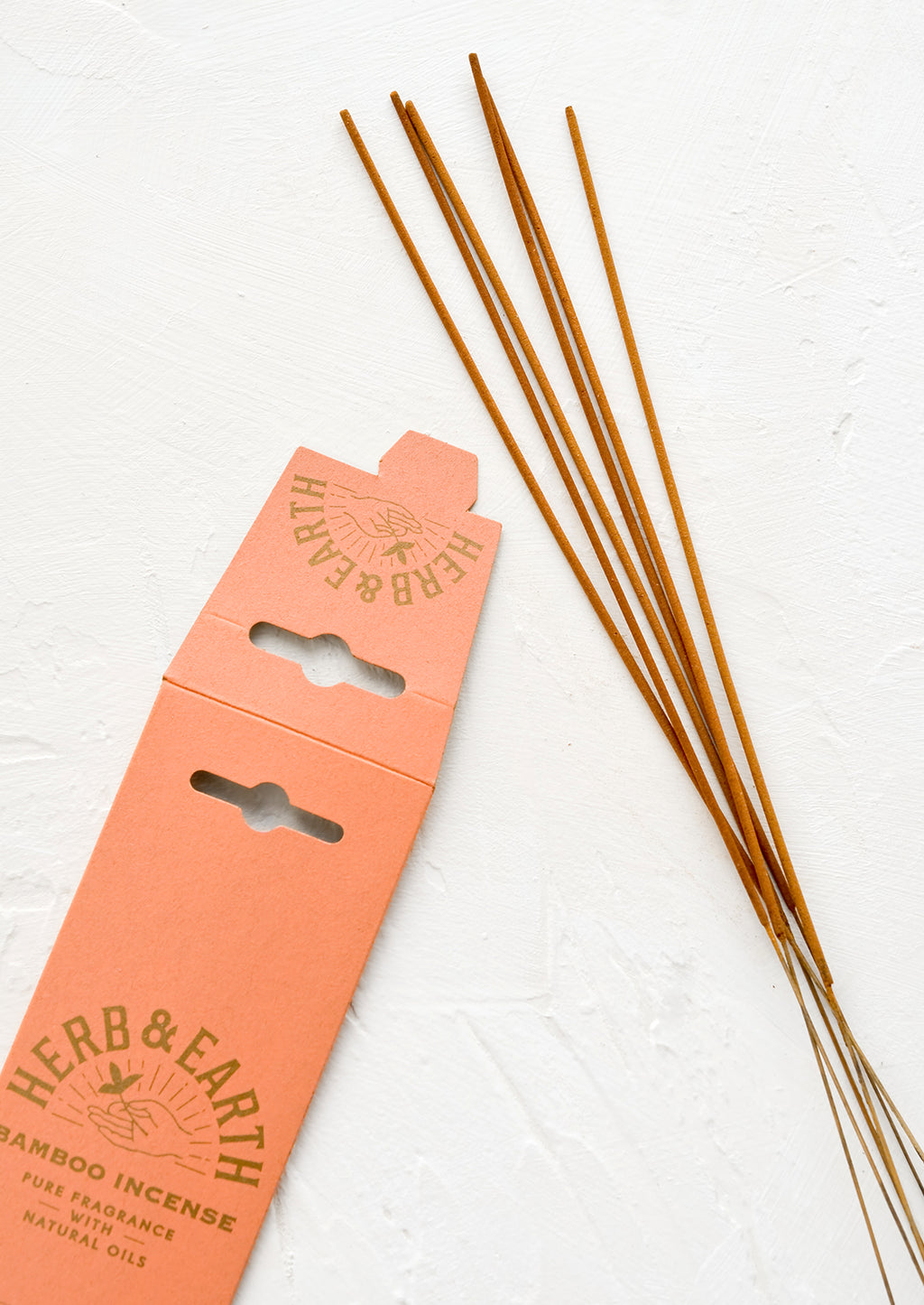 2: Long, skinny sticks of dipped incense on bamboo sticks.