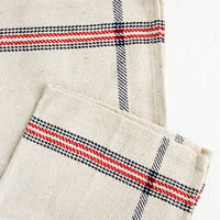 Natural / Red / Navy: Thick woven cotton kitchen towel in natural with blue and navy plaid stripe