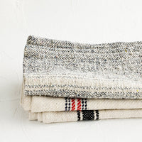 1: Stack of thick woven cotton towels in assortment of natural, blue and red colors