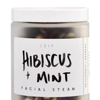Hibiscus + Mint: A frosted glass jar with a black and white label and white plastic lid.