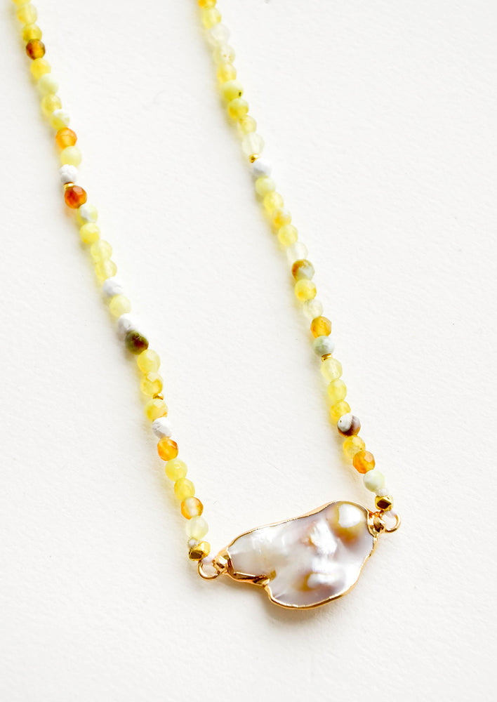 2: Gemstone beaded necklace in shades of yellow with asymmetrical grey pearl pendant at front