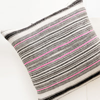 1: Square throw pillow in natural hemp fabric with varied stripes in black and hot pink