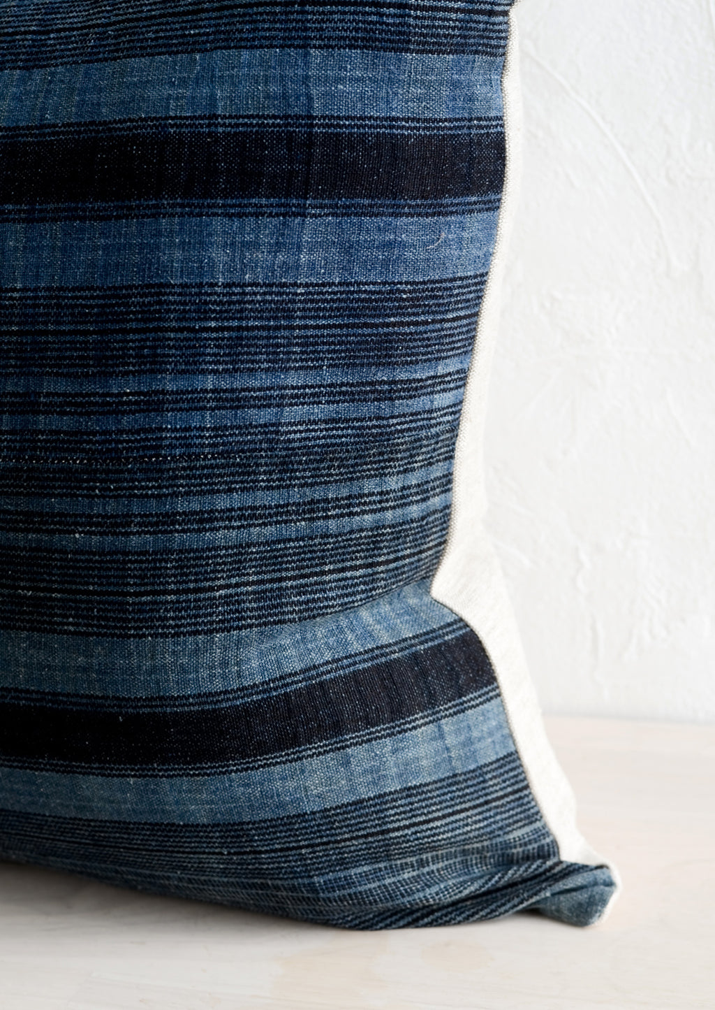 3: Indigo fabric with variegated black stripes.