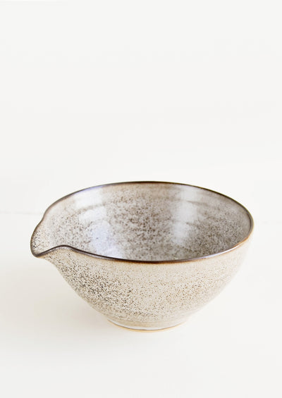 Ceramic bowl in speckled brown glaze with pouring spout