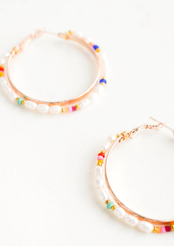 2: Round hoop earrings with beaded outer layer of pearls and colored glass seed beads and rosegold inner hoop