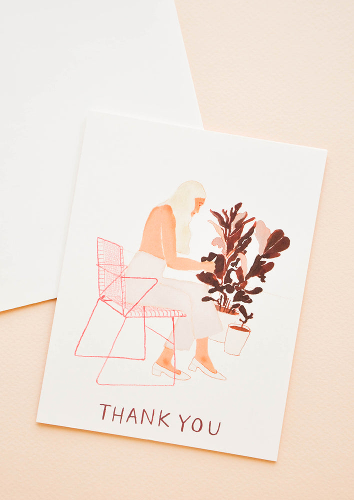 "Notecard with drawing of a woman sitting in a chair pruning plants and the text ""Thank you""."