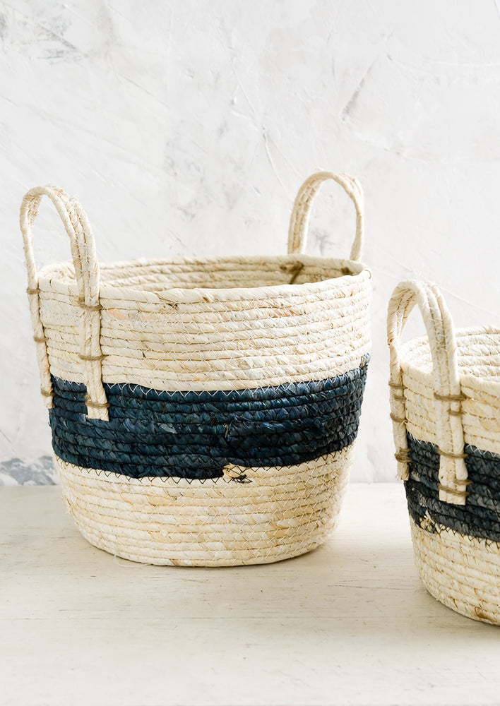 3: Storage baskets woven from natural maize with indigo band around center.