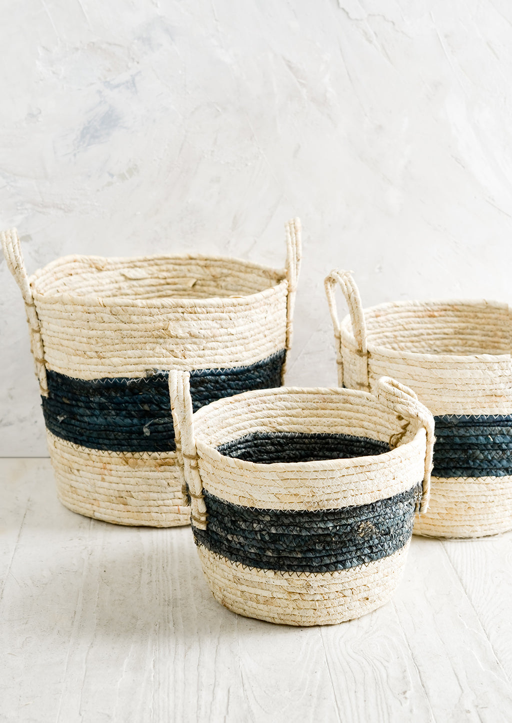 2: Three natural fiber storage baskets in three incremental sizes.