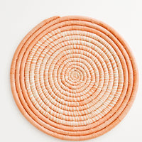 Peach: Hue Woven Raffia Trivet in Peach - LEIF