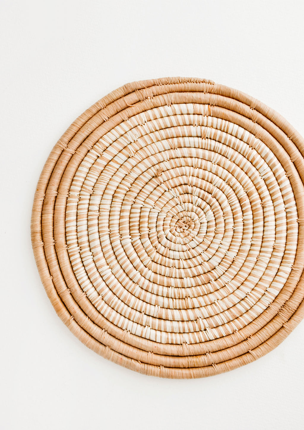 Tan: Hue Woven Raffia Trivet in Tan - LEIF