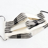 Ivory & Black: Pleated face covering made from ikat woven cotton in ivory and black