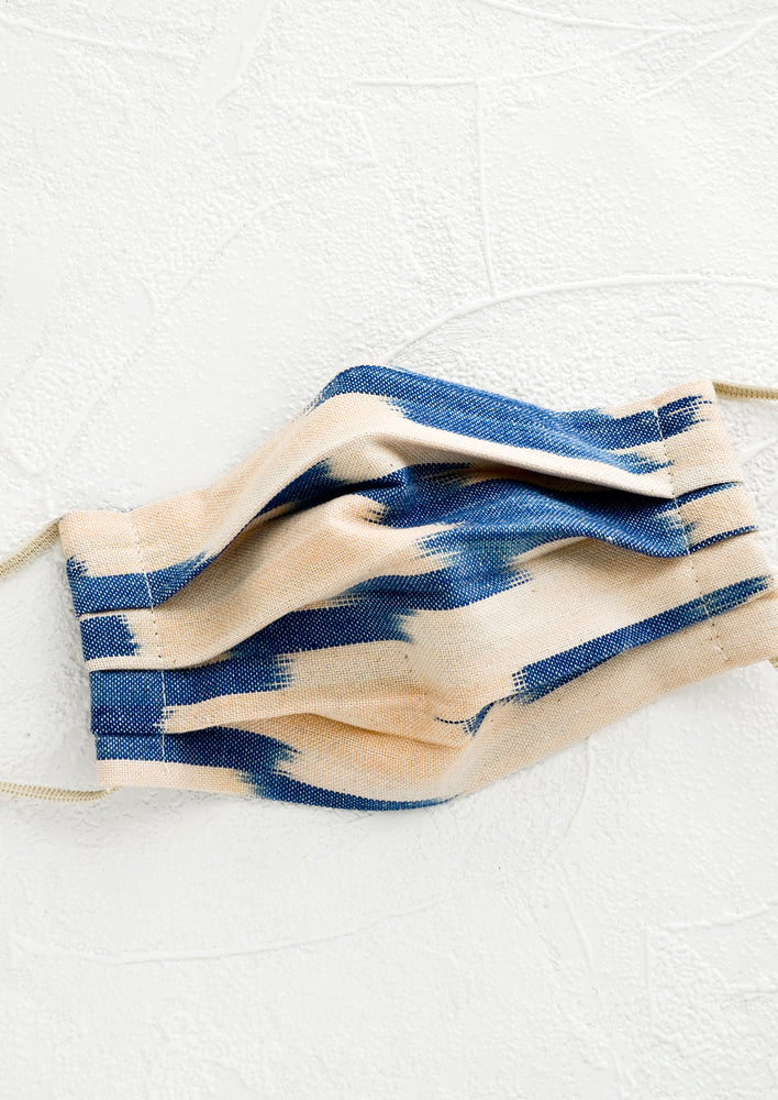 Blush & Indigo: Pleated face covering made from ikat woven cotton in blush and indigo