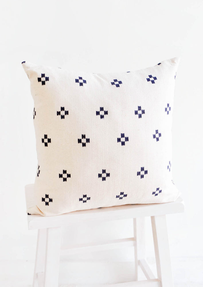 1: Square throw pillow in ivory with navy blue crosshatch print throughout front