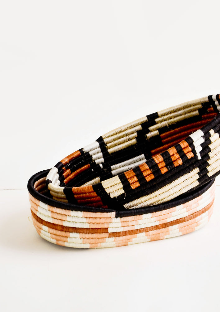 3: Oval shaped shallow bread baskets made from woven natural grass in geometric patterns