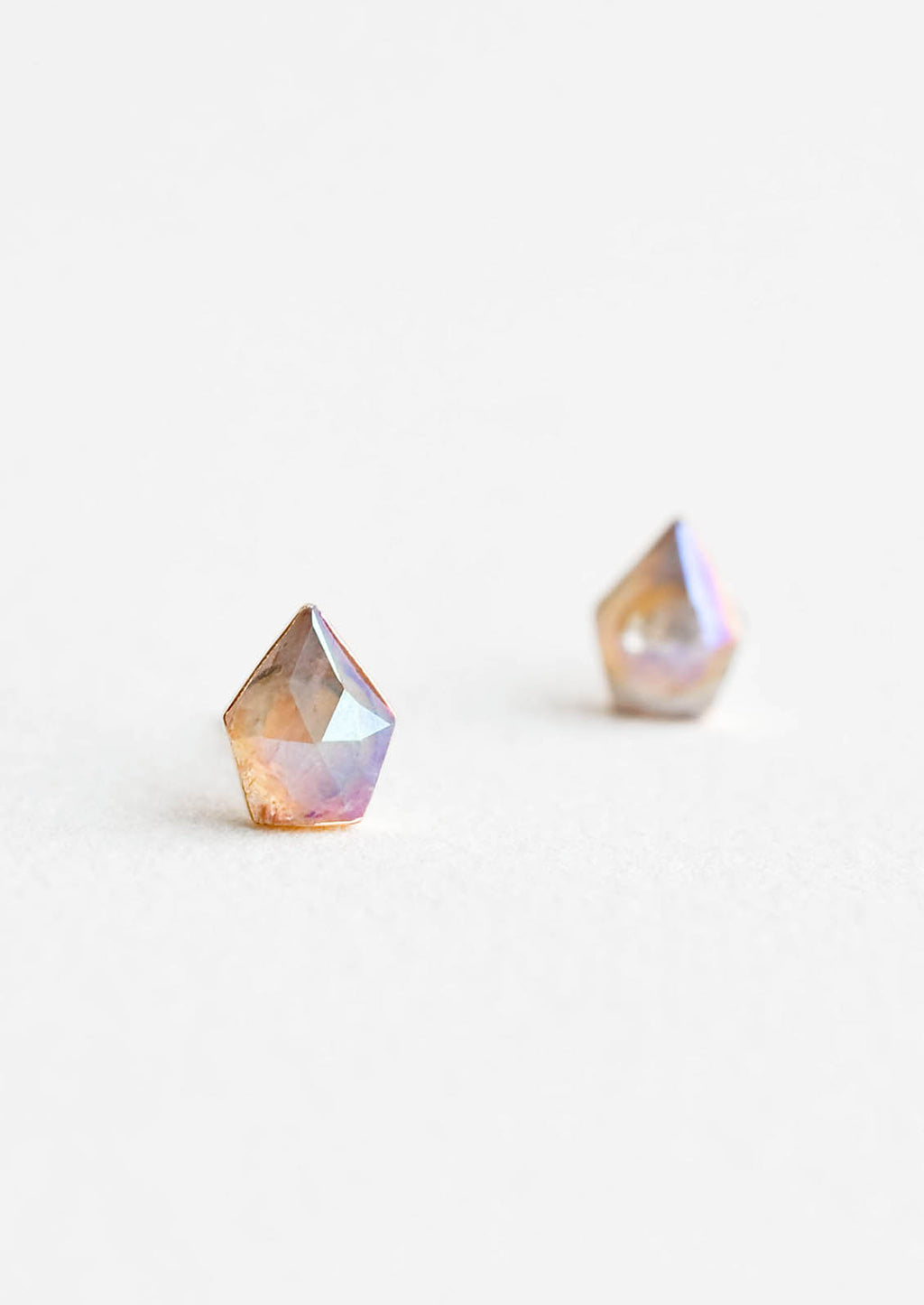 1: Faceted, gemstone shaped earrings with rainbow-like iridescent finish.
