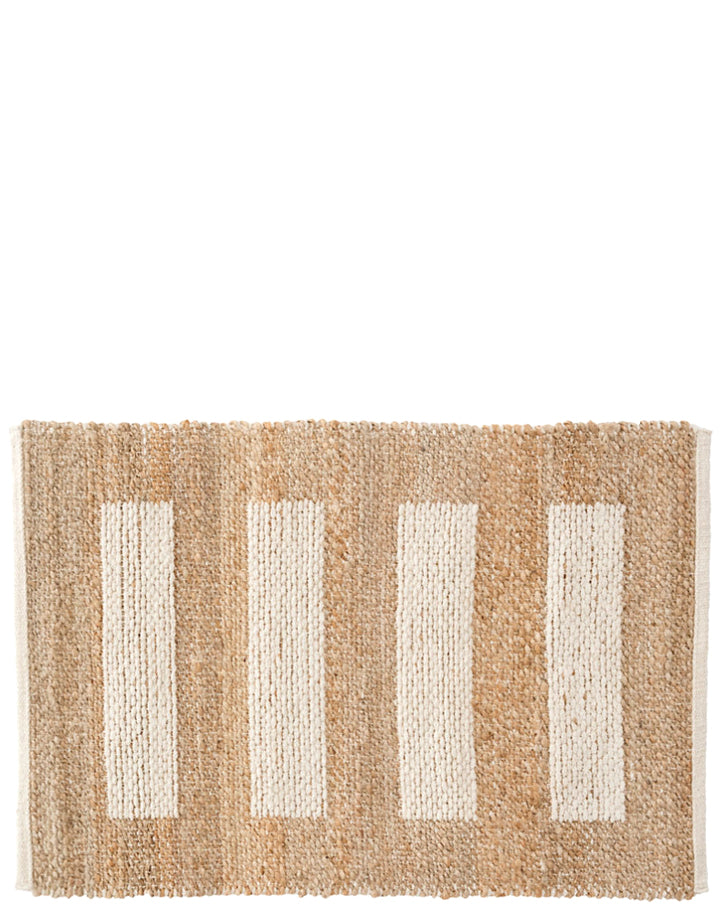 3: Reverse side of rug in natural jute with contrasting ivory cotton bar stripe pattern.
