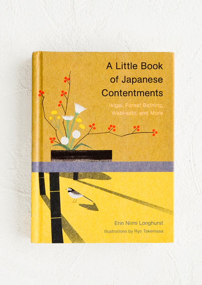 "A small yellow book titled ""A little book of Japanese Contentments""."