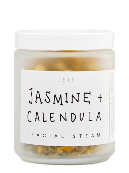 Jasmine + Calendula: A frosted glass jar with a black and white label and white plastic lid.
