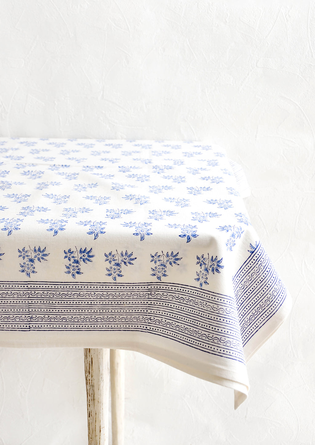 2: White cotton tablecloth with blue floral print and patterned border