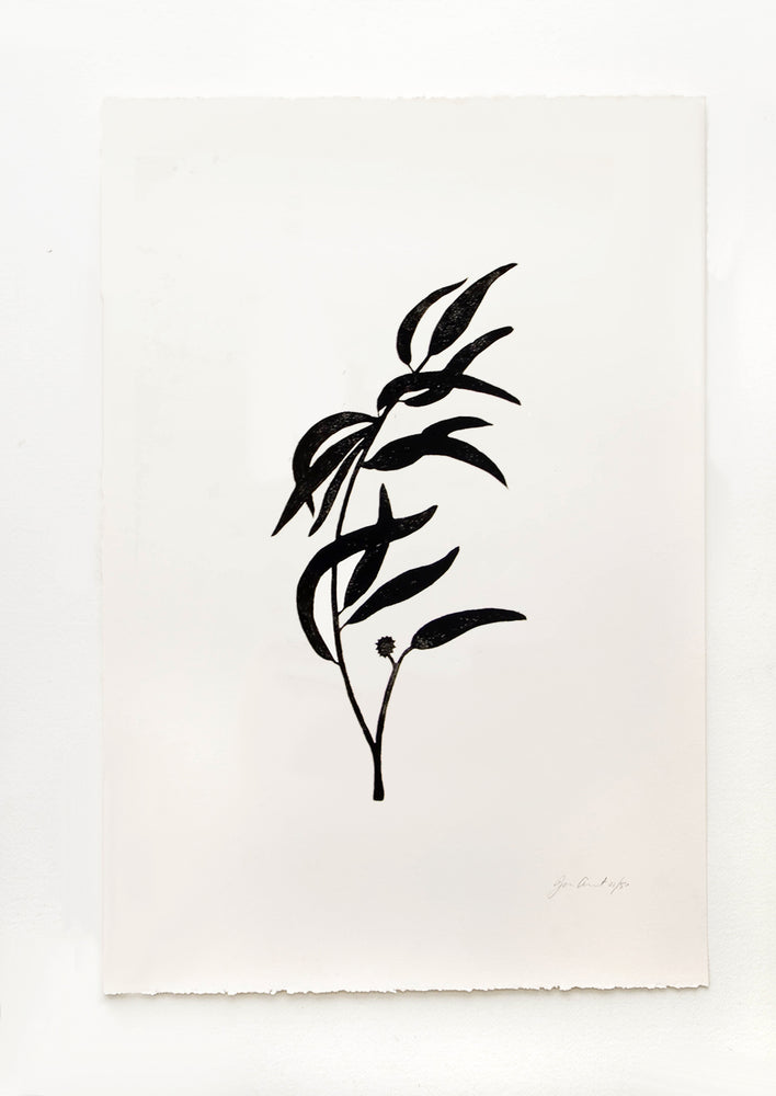 1: Hand printed artwork with off-white background and black silhouette of eucalyptus branch
