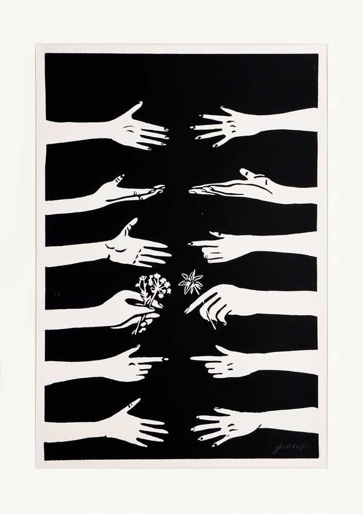 1: Hand printed artwork with black background and white printed hands reaching across to each other
