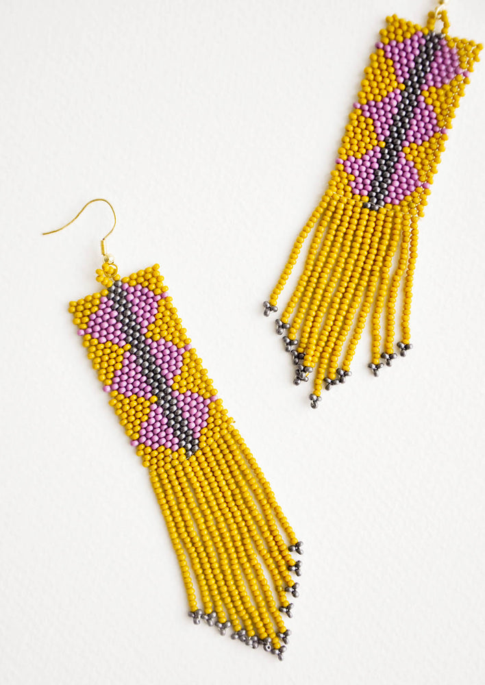 Lichen Multi: Dangling beaded fringe earrings featuring yellow and purple beads.
