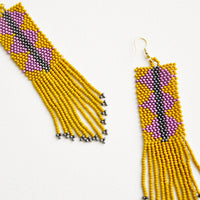 4: Dangling beaded fringe earrings featuring yellow and purple beads.