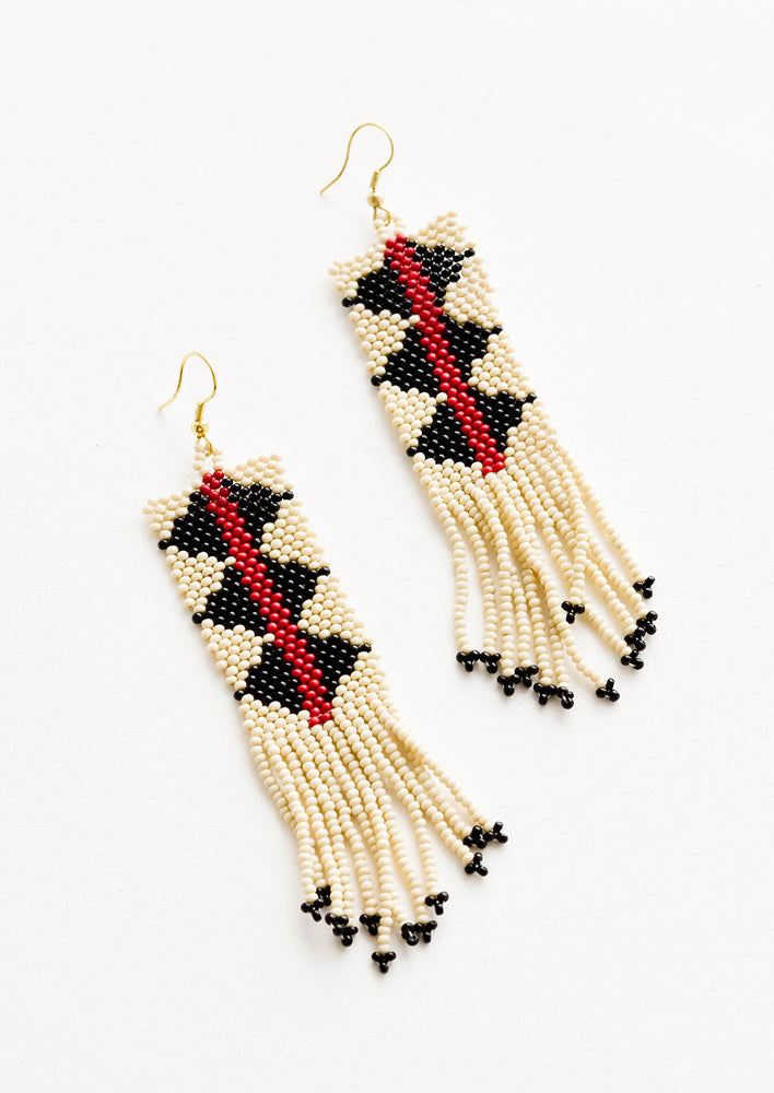 Ivory Multi: Dangling beaded fringe earrings featuring ivory, dark red and black beads.