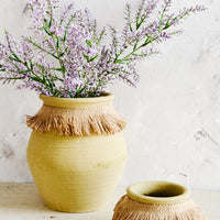 5: Clay pots with jute trim around neck, one displaying purple flowers