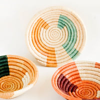 1: Assortment of three woven raffia bowls in a mix of color combos