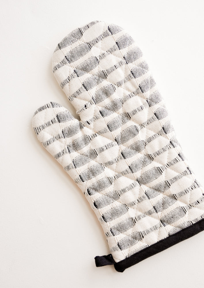 2: A black and white striped oven mitt.
