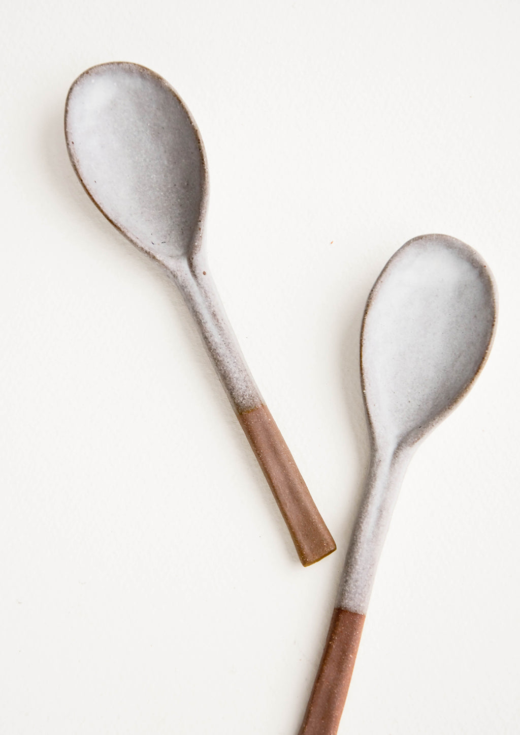 2: Ceramic soup spoons in earthy brown clay dipped in white glaze