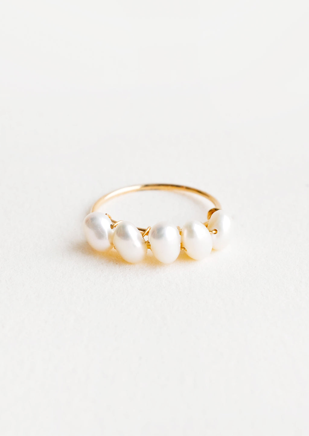 1: Thin gold ring with multiple pearls wrapped around front