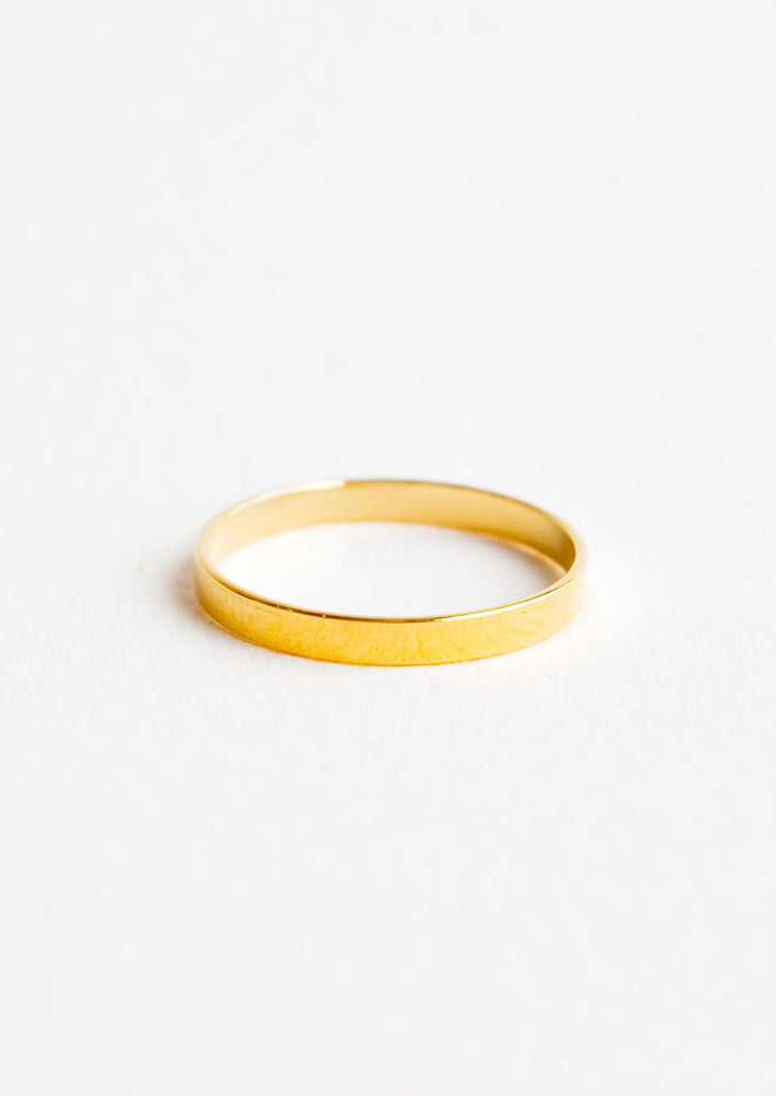 Yellow gold ring with plain medium band.