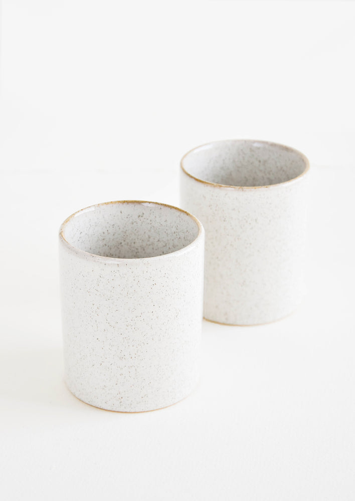 1: Pair of small, lightly speckled ceramic cups