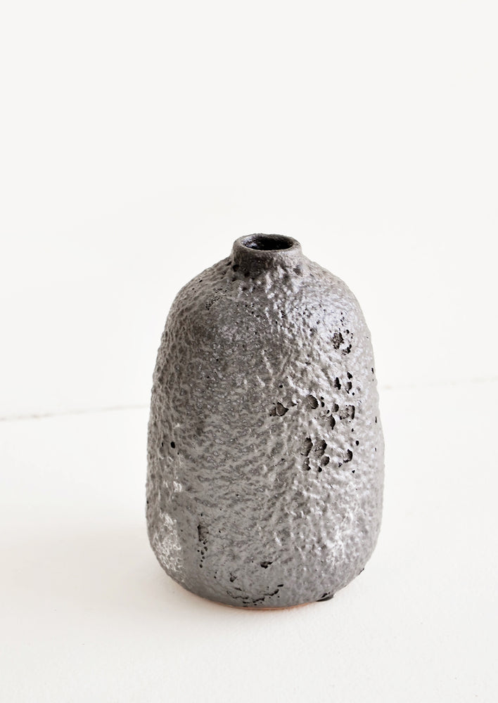 Large / Mercury: Heavily textured, tall ceramic bud vase in a metallic, crater-like dark grey glaze