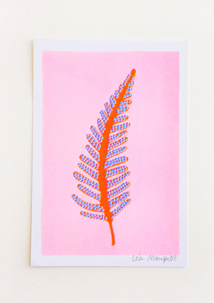 Risograph art print with neon pink background and orange and purple fern frond