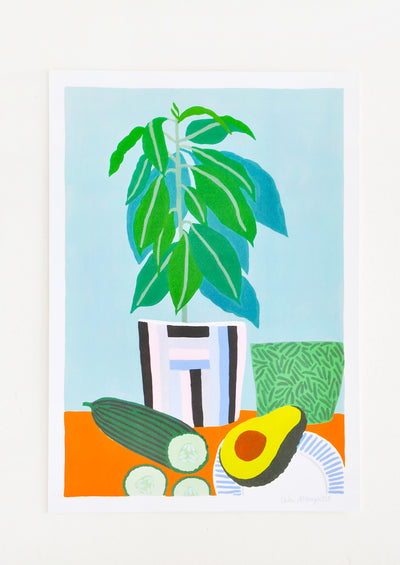 Still life of a cut cucumber, half an avocado, and a houseplant on an orange table against a pale blue background.