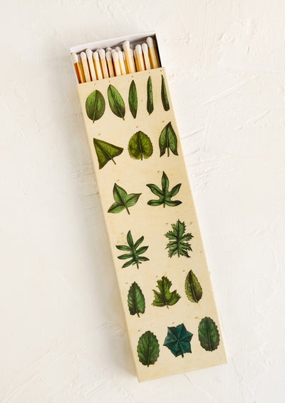 Extra long matchstick box with leaf print container and white tipped matches.