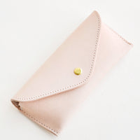 Natural: Pale pink leather case for sunglasses that folds close with a snap.
