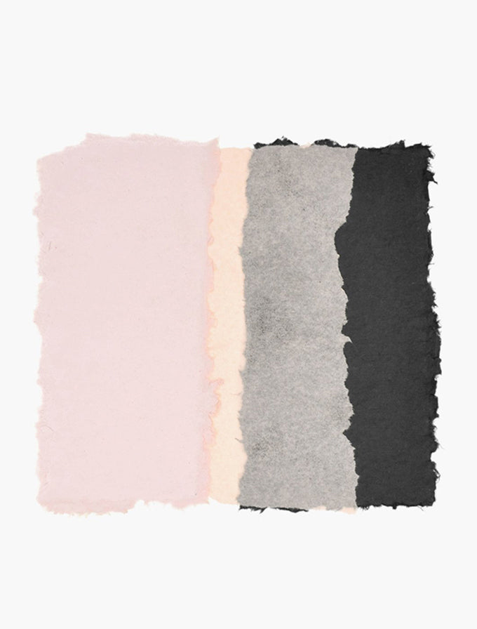 1: A rough edged square is formed by sections of pink, peach, gray, and black sits at the center of a white canvas.