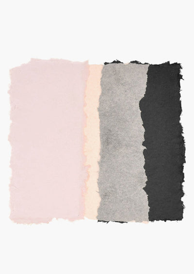 A rough edged square is formed by sections of pink, peach, gray, and black sits at the center of a white canvas.
