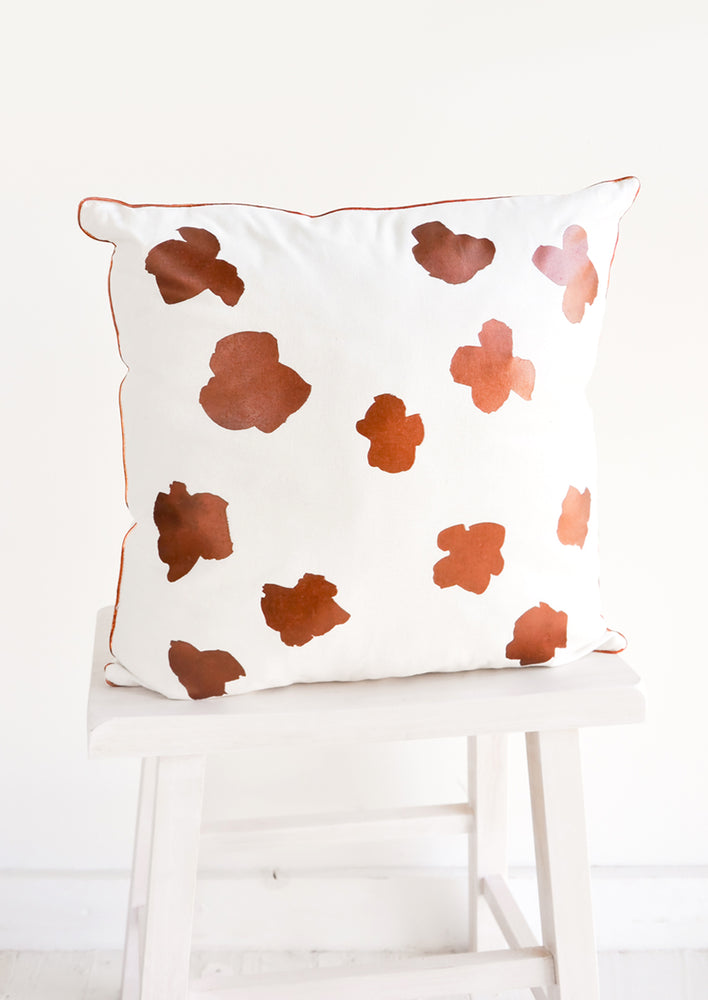 1: Square Throw Pillow in White with Copper Abstract Flower Print on Front
