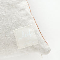 3: Logo patch on linen pillow back