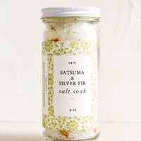 Satsuma & Silver Fir: A straight sided glass jar containing Satsuma & Silver Fir salt soak.