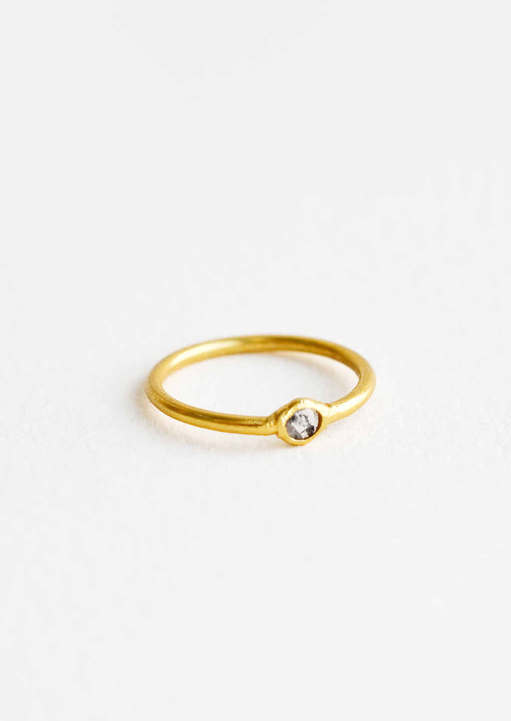 1: Yellow brass ring with a slim band and a small diamond stone.
