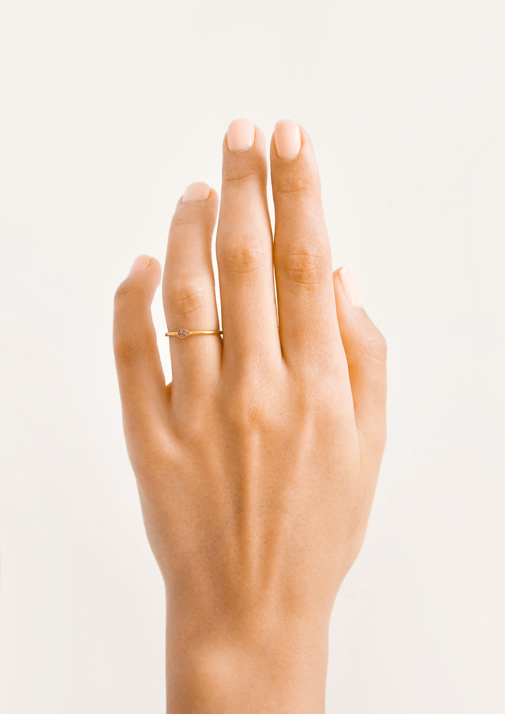 2: Model shot showing hand wearing diamond ring.